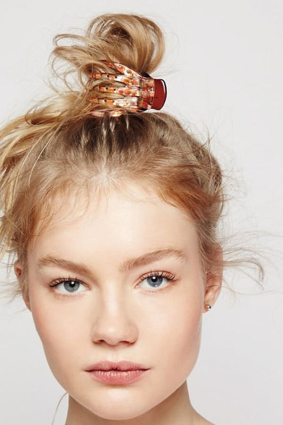 7 Easy Hairstyles You Can Do with a Claw Clip via @PureWow