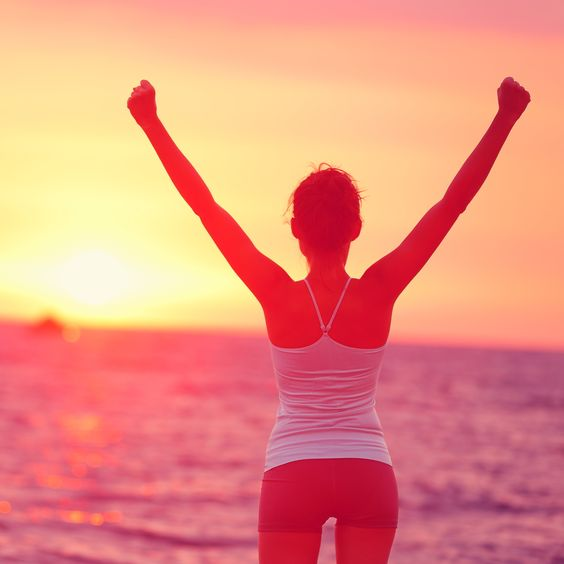 Life achievement - happy woman arms up in success becoming your best self