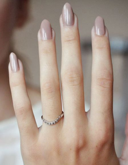 Sophisticated and feminine nude oval nails