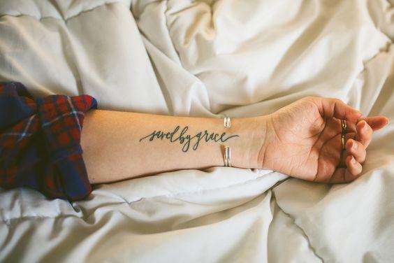 'Saved By Grace'. Script Tattoo designed by Juliet Grace Lapham.