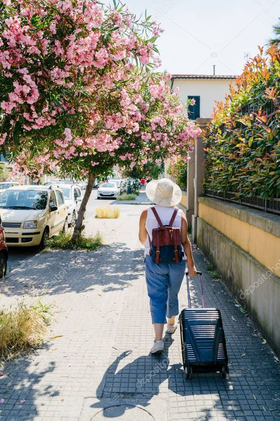 Woman in hat with suitcase and backpack is walking on city street in sunny summe , #ad, #suitcase, #backpack, #Woman, #hat #AD