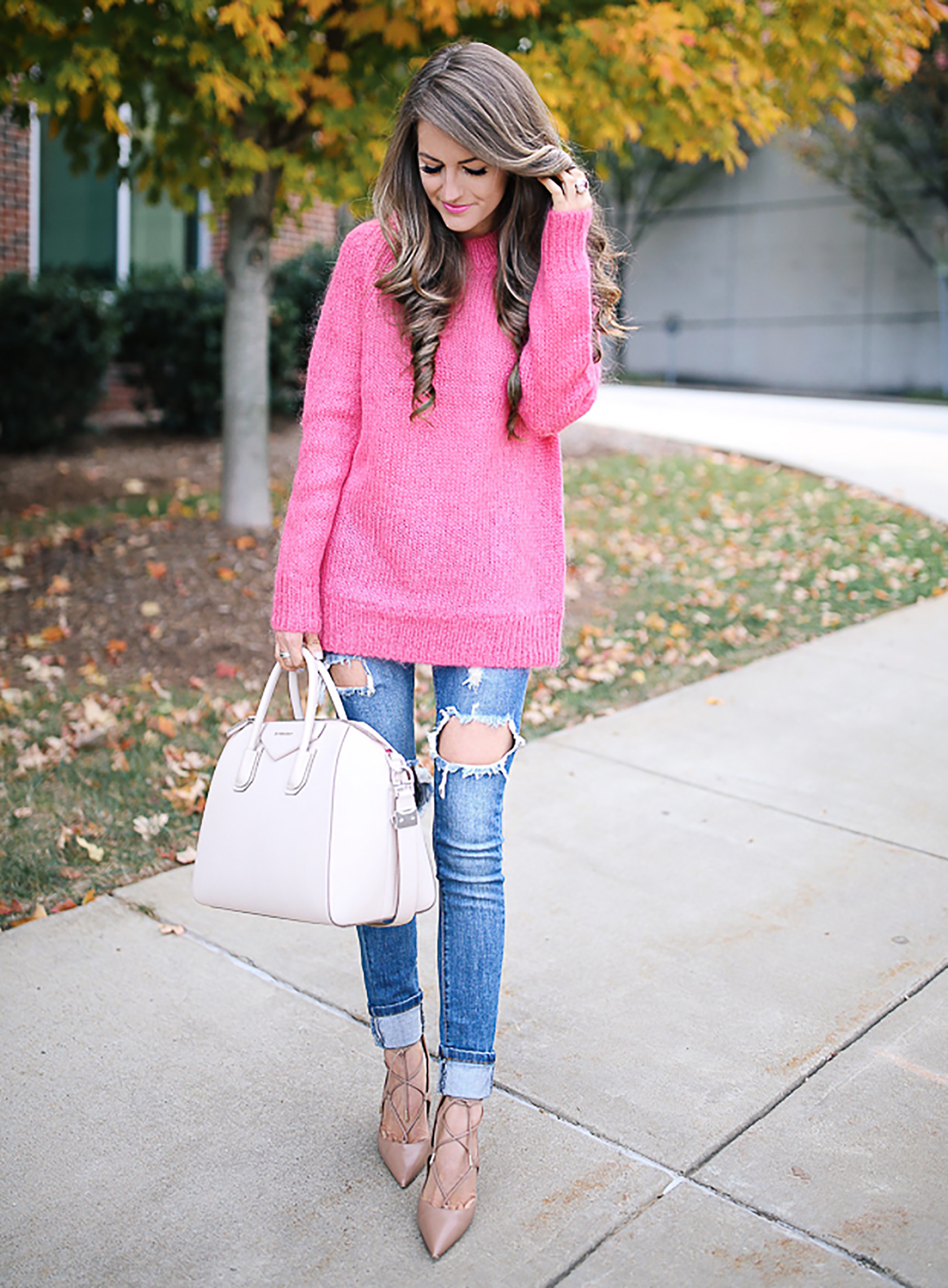 Sydne Style shows pink outfit ideas for fall with fashion blogger southern curls pearls in hot pink sweater