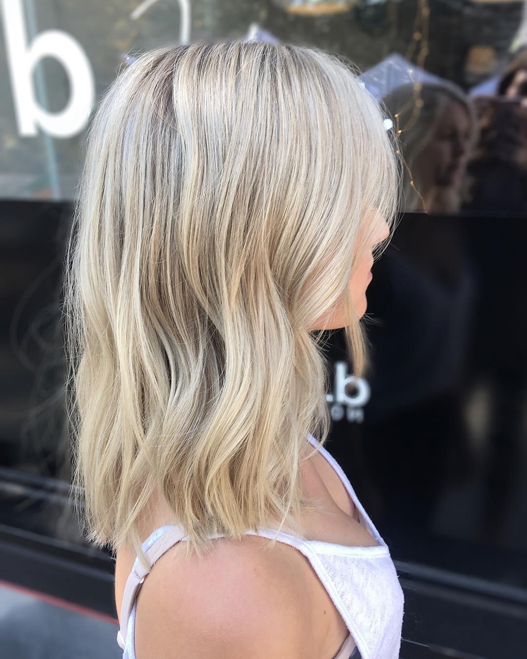 Shoulder-Length Wavy Warm Blonde Cut