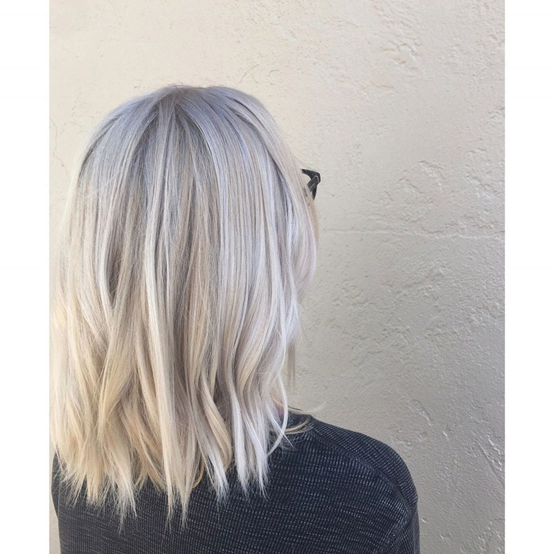 Shoulder-Length Cool Blonde Cut with Lowlights medium hairstyle for women with glasses