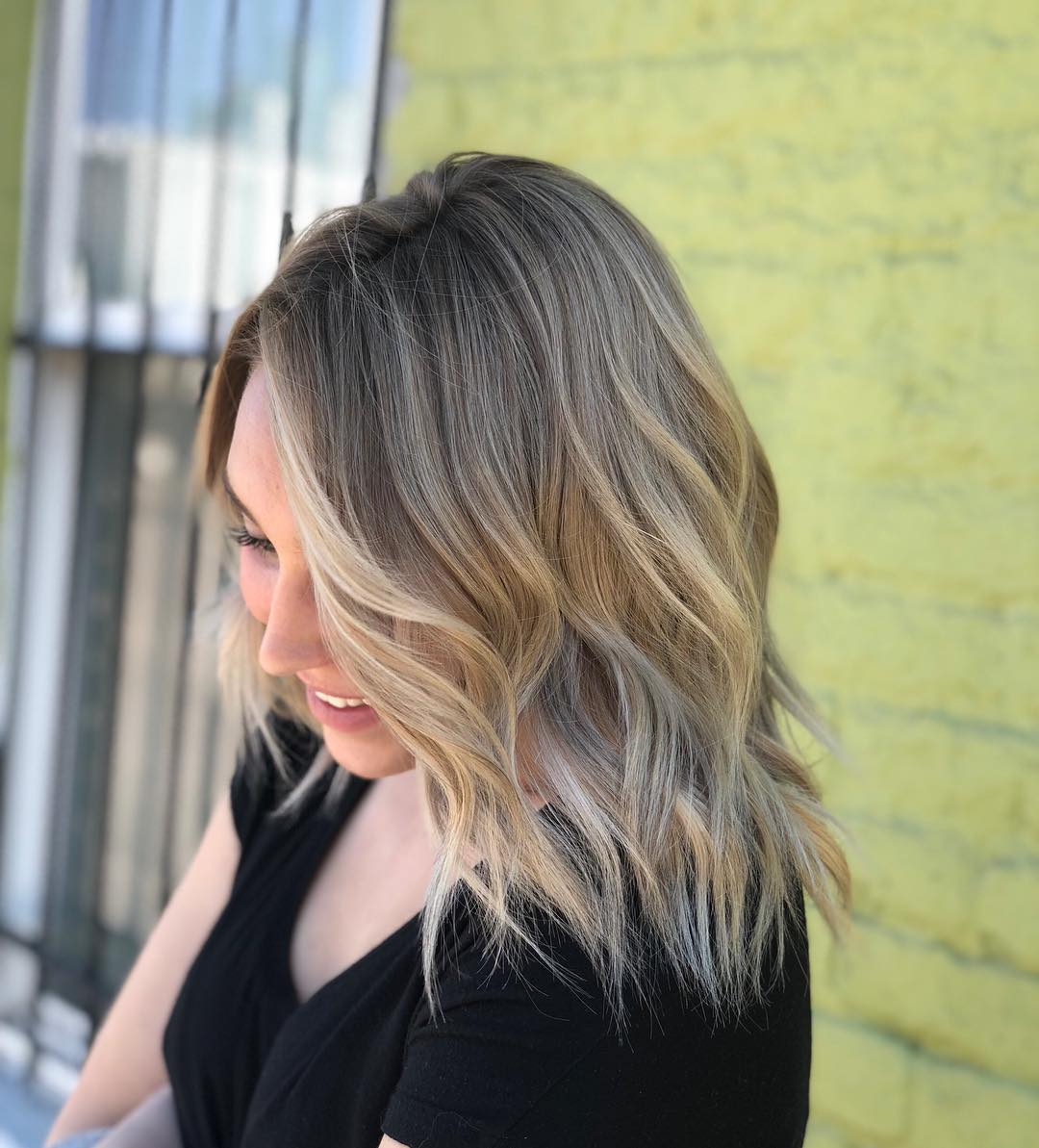 Side view of medium hairstyle with balayage