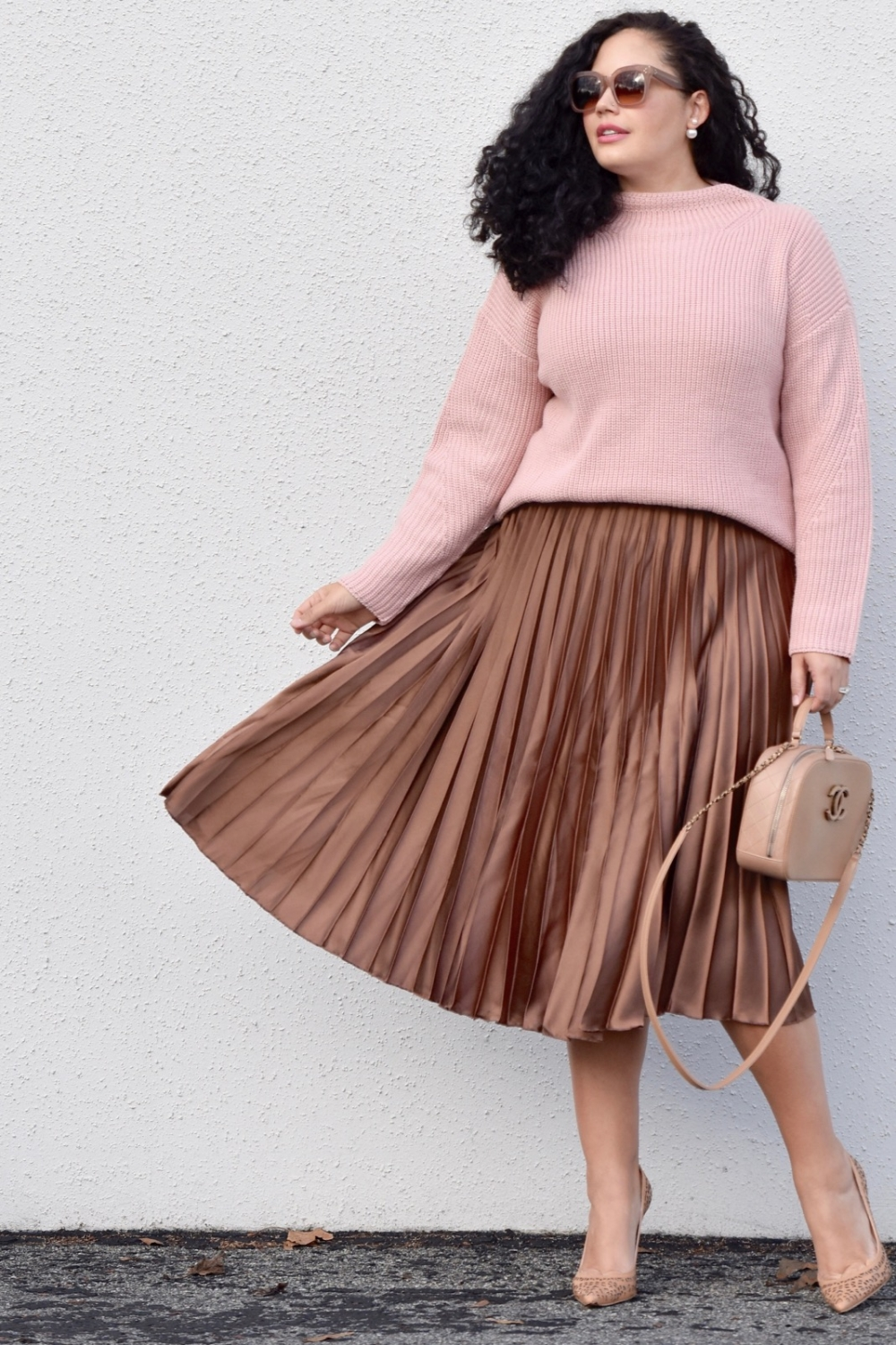 Girl With Curves blogger Tanesha Awasthi wears a Satin Skirt and high neck sweater.