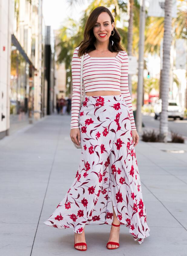 mixed prints trend by pairing a floral maxi skirt with a striped top