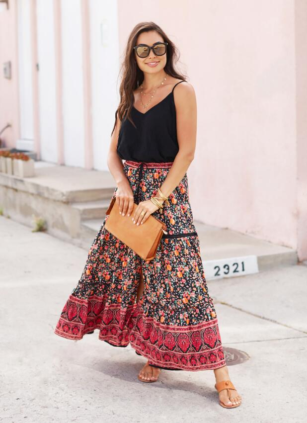For a breezy outfit, pair a boho skirt with a simple cami like With Love From Kat.