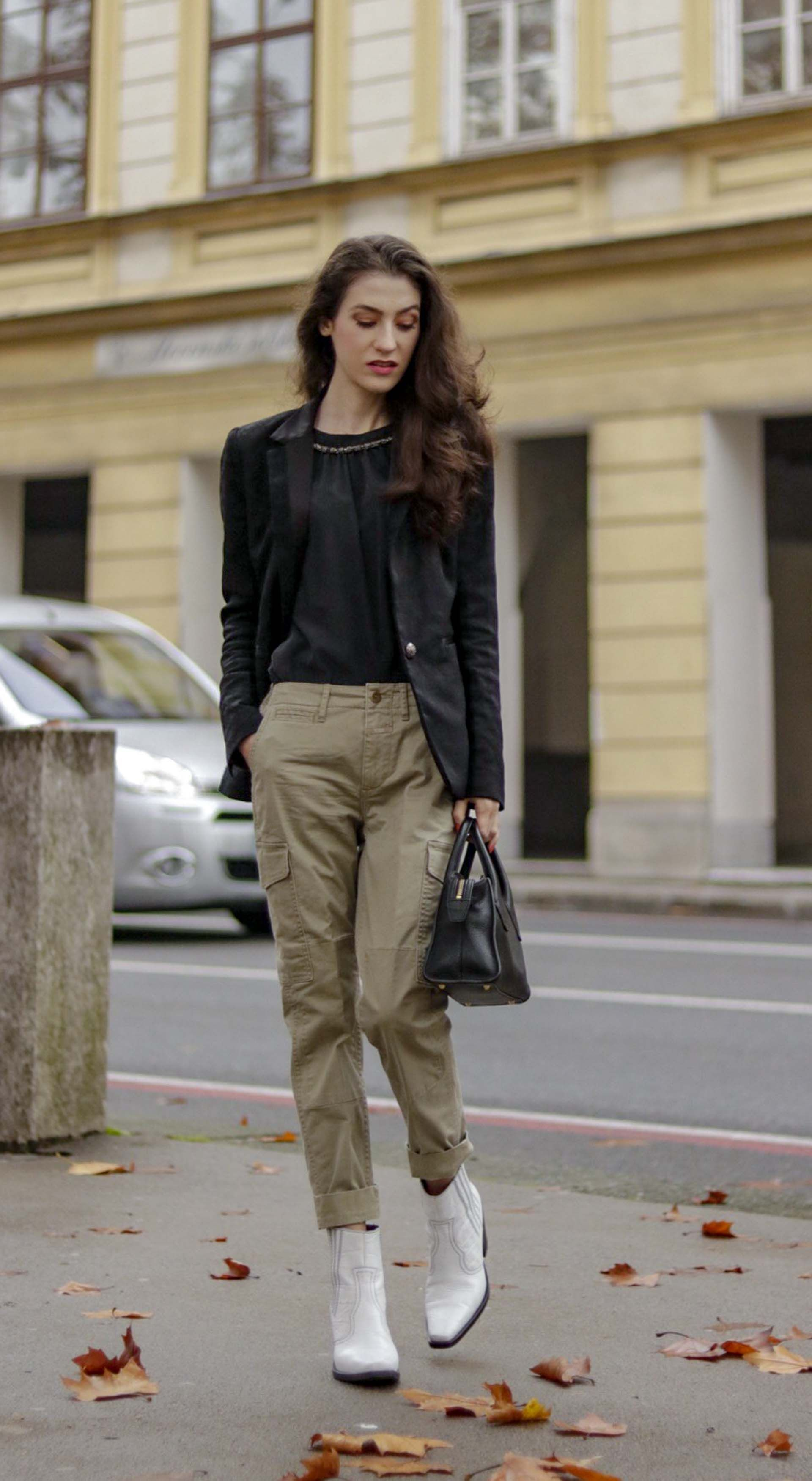 Fashion Blogger Veronika Lipar of Brunette from Wall Street showing how Parisians wear cargo pants #fashion #blog… | Fashion, Summer city fashion, Street style chic