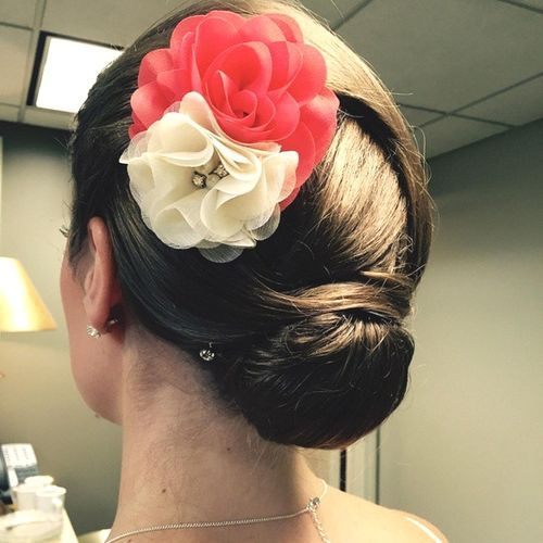 Unique Twisted Bun with Floral Decorations for Medium Hair
