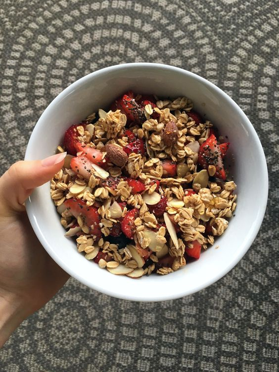Healthy quinoa bowl with quinoa, 1/2 tbsp of honey, 1/4 cup of almond milk, blueberries, strawberries, bananas, 1/2 tbsp of almonds, 1/2 tsp of chia seeds, 1 tbsp of vanilla granola, 1/4 tsp of honey to top it with!
